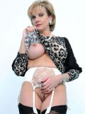 Round assed milfy fetish model Lady Sonia poses in nylons and high heels