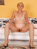 Slim granny with hairy snatch take off her thong and opens her legs for fucking