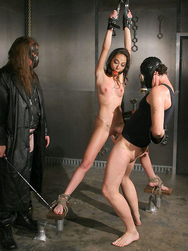 Two guys in masks are ripping the tender holes of the poor slave Veronica Jett.