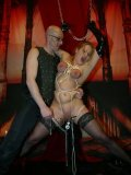 Big breasted slave girl Justine with pierced snatch gets rope bound and covered in wax