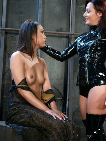 Latex domina Sandra Romain spanks bare asian ass of slave Veronica Lynn and gets her anus licked