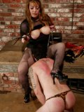 Slave man Brandon licks latex shoes of domme Gabrielle after CBT and whipping