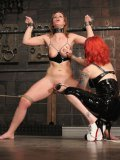 Inked up redhead domina gives pain to cute restrained slave girl Tara Lynn