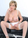 Mature babe in white lingerie Lady Sonia demonstrates her bare bubble ass and shaved snatch
