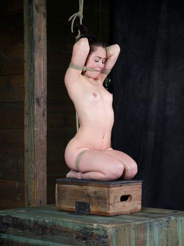 Beautiful babe Kristina Rose with natural plump tits is hanging hogtied with her mouth gagged.