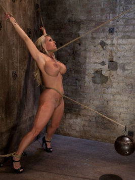 Milf Holly Halston gets her huge dirty nipples pinched while Isis Love whips her and humiliates her