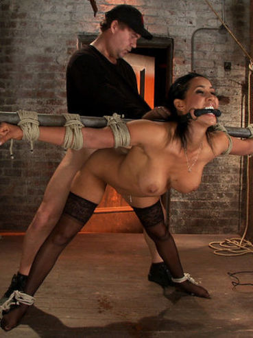 Isis Love in kinky and hardcore bondage while gagged and getting her shaved slit vibrated hard.