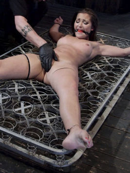 Dani Daniels immobilized during hardcore bondage whit chains and kinky toys inside her muff.