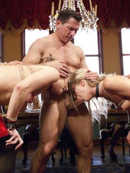 Bailey Blue sharing intimate and hardcore bondage moments with her blonde companion Karla Kush.