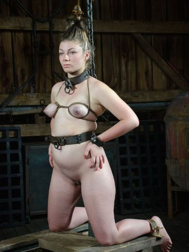 Harley Ace gets stripped down in a barn and goes through bizarre bondage after getting spanked.