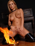 Brave smooth pussy blonde Dorothy Black in high boots playing with fire