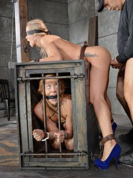 Simone Sonay is pulled out of the cage, she is bound and fucked hard from behind during bondage.