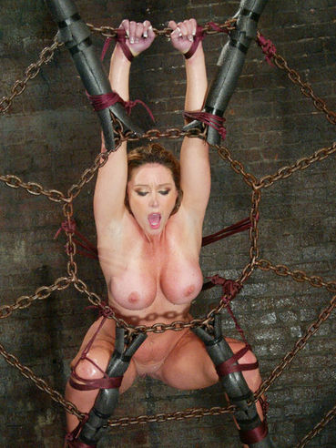 Big racked slave milf Christina Carter gives water bondage a try in the dungeon