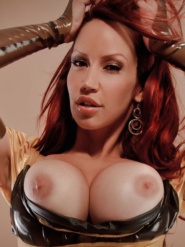 Charming redhead Bianca Beauchamp dressed in latex pulls out her perfectly shaped big boobs
