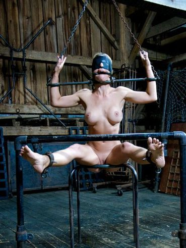 Cherie DeVille gets tied up in bondage and gets her body covered in hot wax