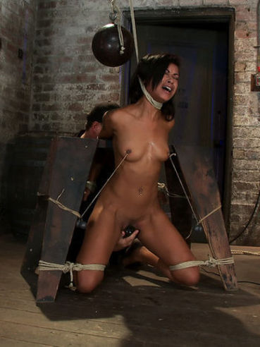 Ebony babe Skin Diamond gets her titties pinched and body stimulated with ropes during bondage.