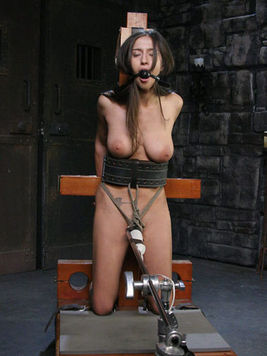 Big titted slave girl April Oneil with ball gag in her mouth gets her slit rubbed with vibrator