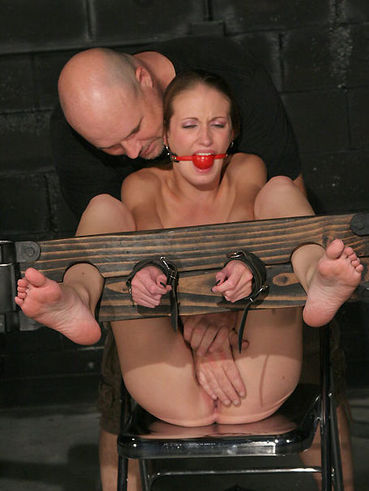 Two masters try every kind of punishment as they play with slim slave girl Hailey Young