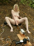 Completely nude busty blondie Cowgirl enjoys the Intruder on the ground