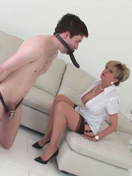 Big breasted femdom Lady Sonia sucks and fucks a strap-on attached to this dude's face.