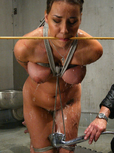 Delilah Strong gets roped and handcuffed behind the bars before dunking