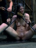 Naked restrained brunette Kristine Kink gets her feet and ass seriously caned