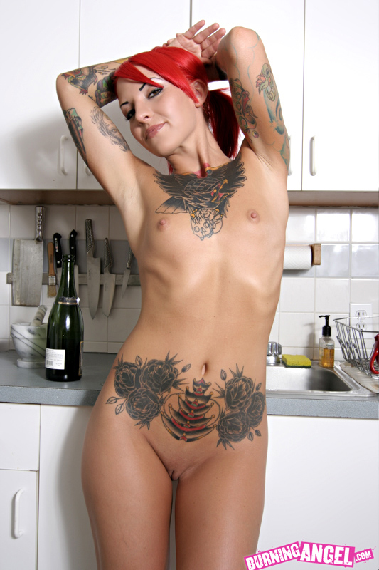 ebony nude tattooed females