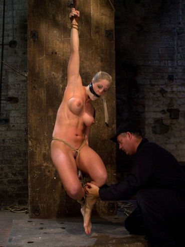Naked big titted slave blonde Holly Heart in a kind of mask is about to hang from the ceiling