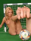 Eleanor removes her soccer uniform and takes girl's toe in her shaved pussy