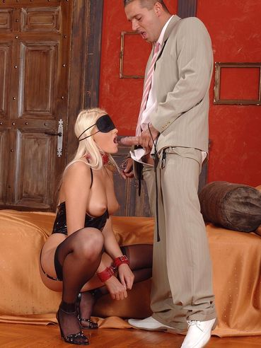 Stockinged blonde Gabriela gets her ass spanked with a pee drenched paddle