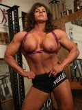 Shameless bodybuilder Laurie Larson works out and exposes her big shapely DD boobs