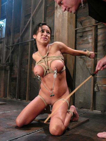 Oiled up slave brunette Nadia Styles gets rope bound and slammed by Mark Davis