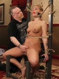 Blindfolded naked slave blonde Hollie Stevens gets punished in the middle of the room