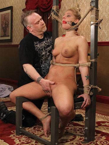 Blindfolded naked slave blonde Hollie Stevens gets punished in the middle of the room