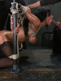 Anissa Kate gobbles and gets fucked by a bunch of enormous dicks in bondage