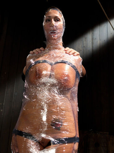 Brunette Trina Michaels has amazing huge tanned boobs which get splashed with water.