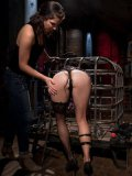 Dana Vespoli caged like an animal, stimulated and fisted by blonde bondage babe Aiden Starr.
