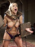 Angel Allwood in kinky stocks getting her nipples pinched and teased during hard bondage.