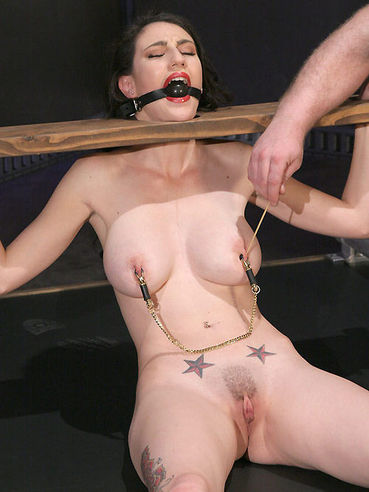 Busty slave girl Natalie Minx gets ruthlessly tortured with hot wax and clamps
