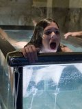 Isobel Wren gets her tis and pussy punished under water in a big glass tank