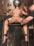 Nude slave girl Lana Phoenix with helpless tight body gets caned in device bondage