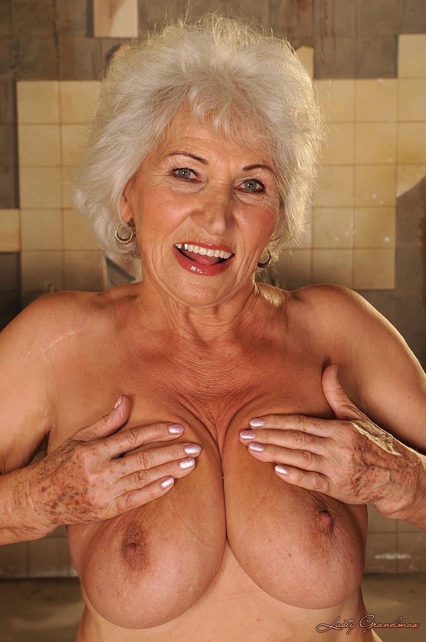 big breasted granny norma takes massive cumshot after riding on top