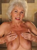 Big breasted granny Norma takes massive cumshot after riding on top of hard dick