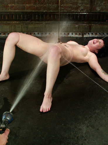 Andy San Dimas experiencing hot stimulation and has her slit vibrated and drilled during bondage.