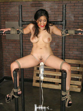 Well-stacked asian slave girl Jessica Bangkok tied to metal frame gets her slit seriously vibrated.