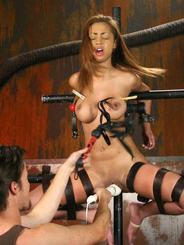 Angel Cummings gets tied to metal bars and vibrated in suspension by master Sir Nik