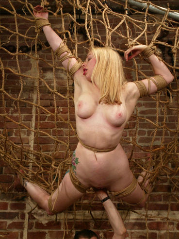 Rope tied Adrianna Nicole gives water punishment a try after tit torture