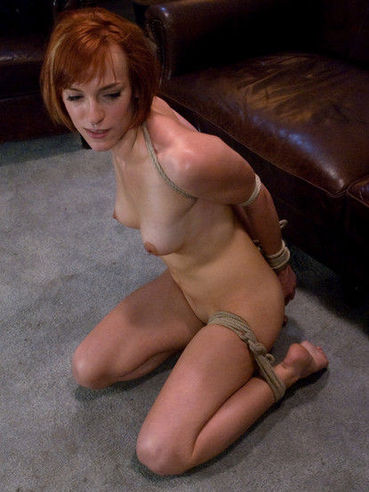 Nude redhead Renee Broadway with shaved snatch and sexy tits gets tied up and stimulated