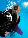 Beautifully dressed stocking babes Hana Black and Daria Glower swim in the pool