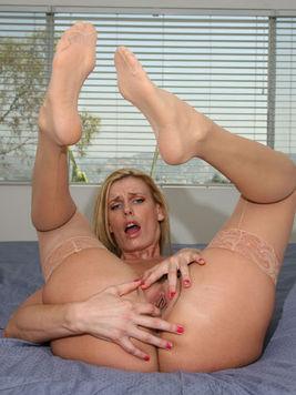 Beautiful long legged milf blonde Darryl Hanah gets hardcore fucked and takes cumshot on her feet